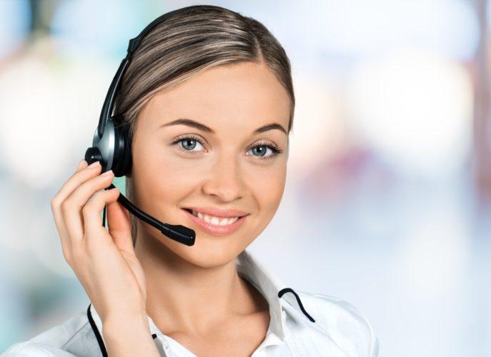 Female Sales Representative wearing head set